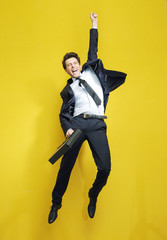 Young succesful businessman in the victory jump