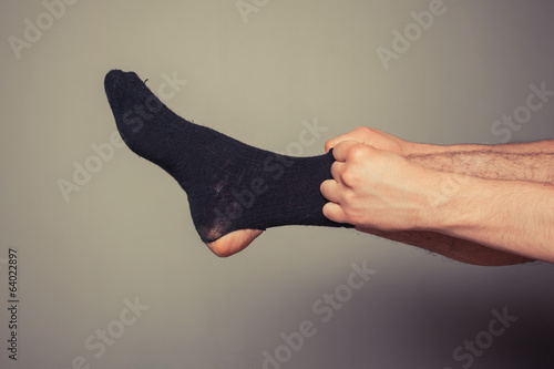 Man putting on socks