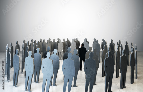 businessman standing among people silhouettes
