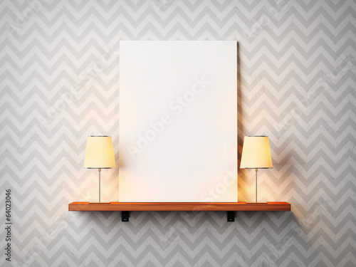 Blank poster on a shelf with two lamps
