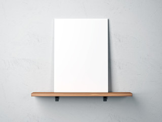 white poster on a shelf