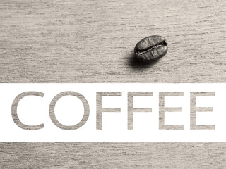 Roasted Coffee Beans on wood texture, retro monotone color backg