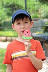 boy eating ice-cream in a park