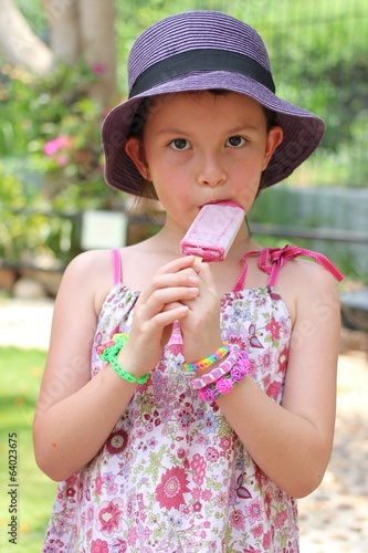 Girl eating ice-cream in zoo wearing rainbow loom