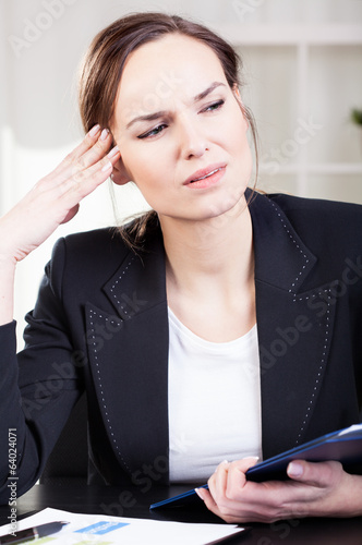 Business woman getting headache