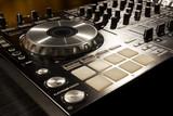 Fototapety Dj mixer at a nightclub.
