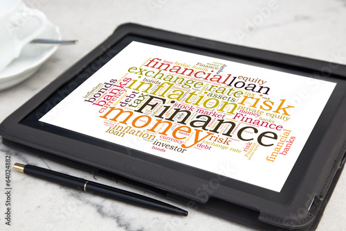 tablet with finance word cloud