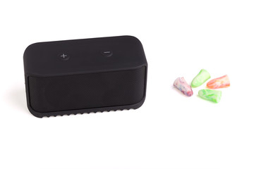 Loudspeaker and Earplugs on White Background