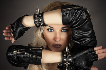 beautiful woman with blue eyes in a leather jacket