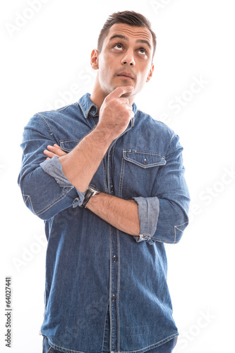 Pensive isolated attractive man over white.