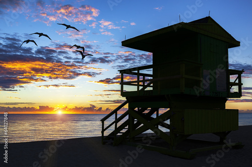 lifeguard tower at sunrise