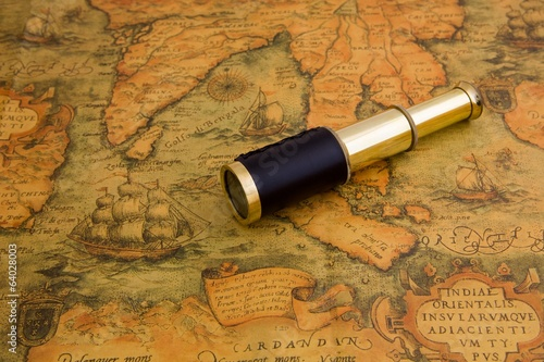 Vintage telescope on a antique map