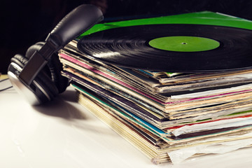 Gramophone records and headphones.