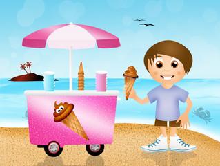 boy eating ice-cream on the beach