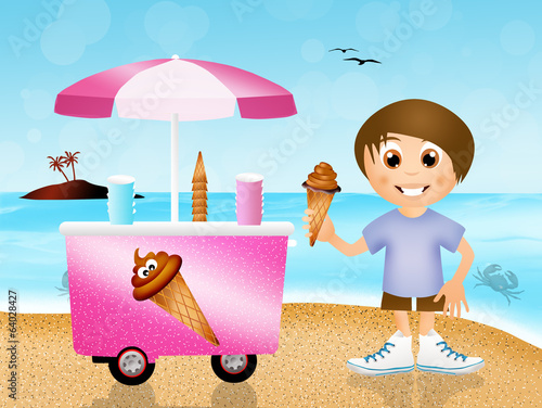 boy eating ice-cream on the beach
