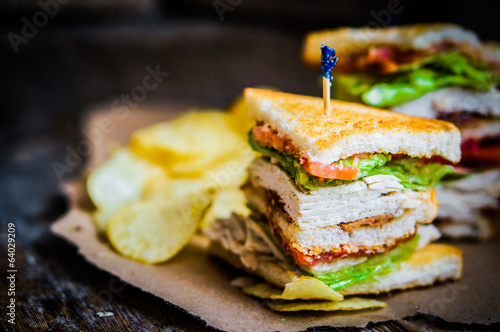 Foto op Canvas Klaar gerecht Club sandwich on rustic wooden background
