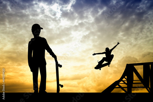 skateboarder silhouette at sunset