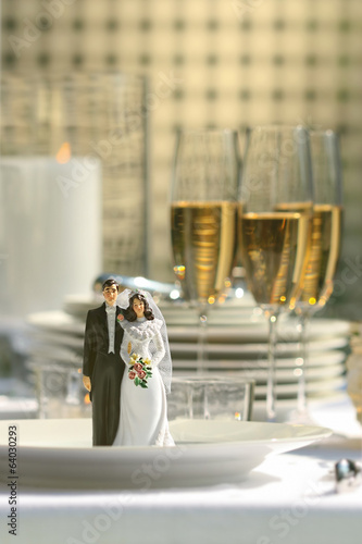Close-up of cake figurines on dinner plate