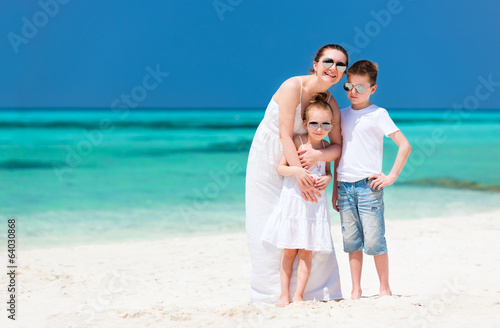 Mother and kids at tropical beach