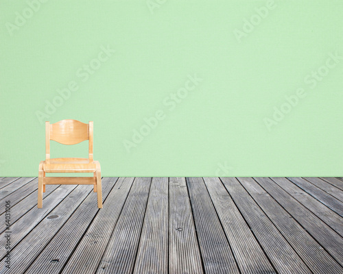 chair on wood floor and wall paper background