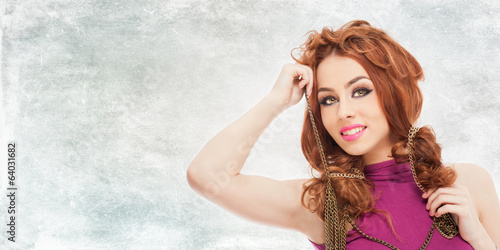 Portrait of beautiful red hair girl with a metallic chain