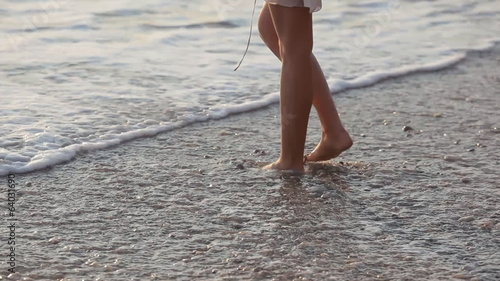 Girl walking on the beach and smiling