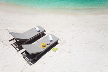Lounge chairs on a beach