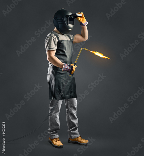 worker welder with gas welding machine