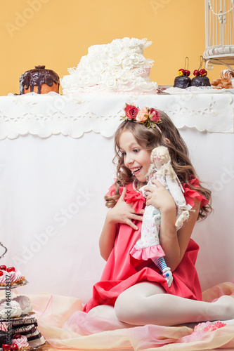 Surprised pretty girl posing with lots of sweets