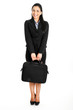 Full length businesswoman holding a briefcase