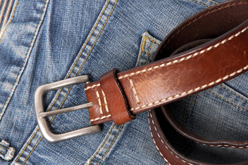 Blue jeans with old brown belt horizontal