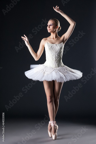 Attractive female ballet dancer posing in studio