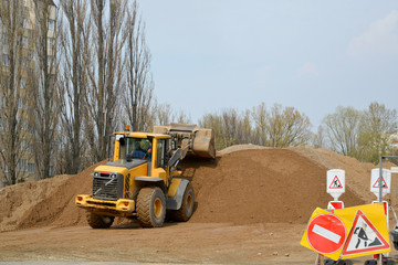 The wheel loader works at bridge construction