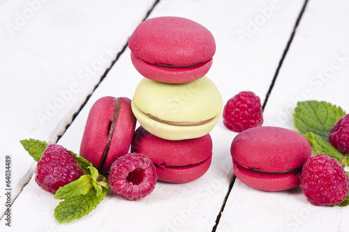 macaroons stacked on white wooden background, cupcakes