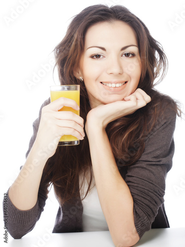 woman with orange juice on white background