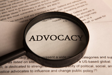 document with the title of advocacy under a magnifying glass