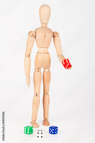 Wood mannequin holding colourful block dice isolated on white