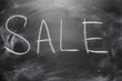 Handwritten message on chalkboard writing message Sale