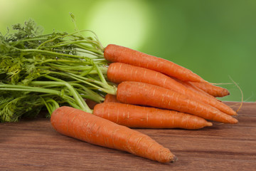 stacked fresh carrots on white background, vegetables