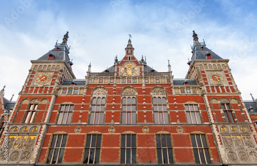 Facade of Amsterdam Centraal old building. Central railroad stat