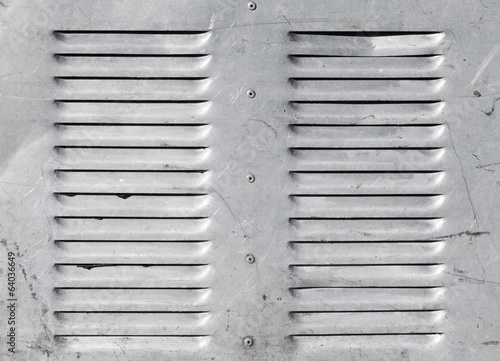 Background with shining metal ventilation grille panels