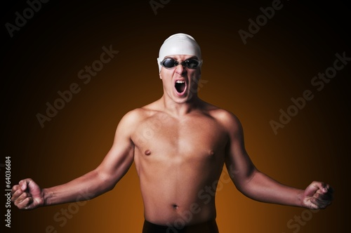 Male swimmer is celebrating