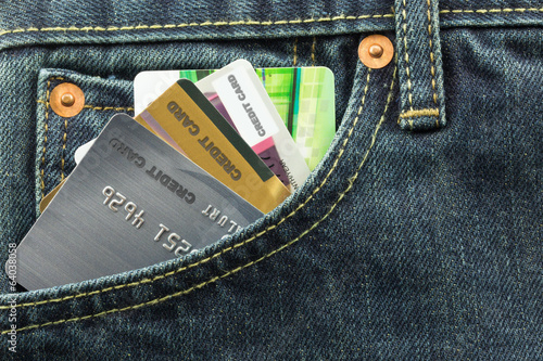 credit cards in blue jeans pocket