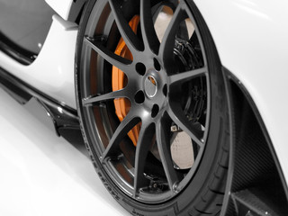 Close up of a sports car´s alloy wheel.