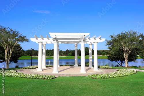 White Gazebo on a Lake Shore with Trees