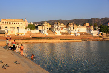 Indian men washing in holy lake, Pushkar, India