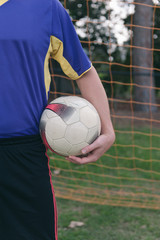 soccer ball under player's arm