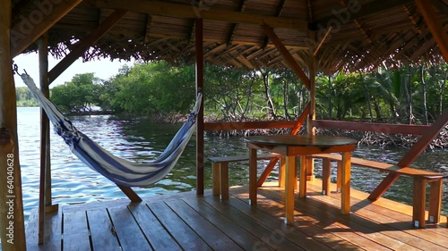 Palapa over water with hammock and table