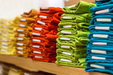 Fototapety Neat stacks of folded clothing on the shop shelves