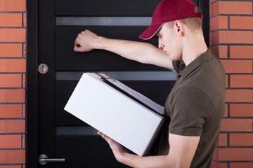 Courier knocking on customer's door
